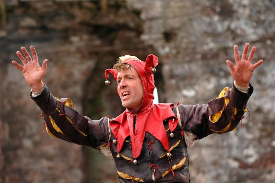 A9R348 Court Jester entertaining visitors to the annual Abergavenny Food Festival Monmouthshire South Wales UK