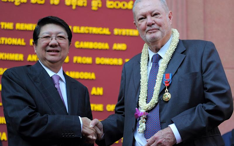 Douglas Latchford, pictured with then Cambodian deputy prime minister Sok An, was once a revered figure in the antiquities world - Tang Chhin Sothy/AFP