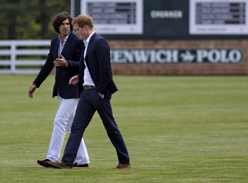 Britain's Prince Harry, right,  walks with polo player Nacho Figueras before the Sentebale Royal Salute Polo Cup charity match in Greenwich, Conn., Wednesday, May 15, 2013. (AP Photo/Craig Ruttle)