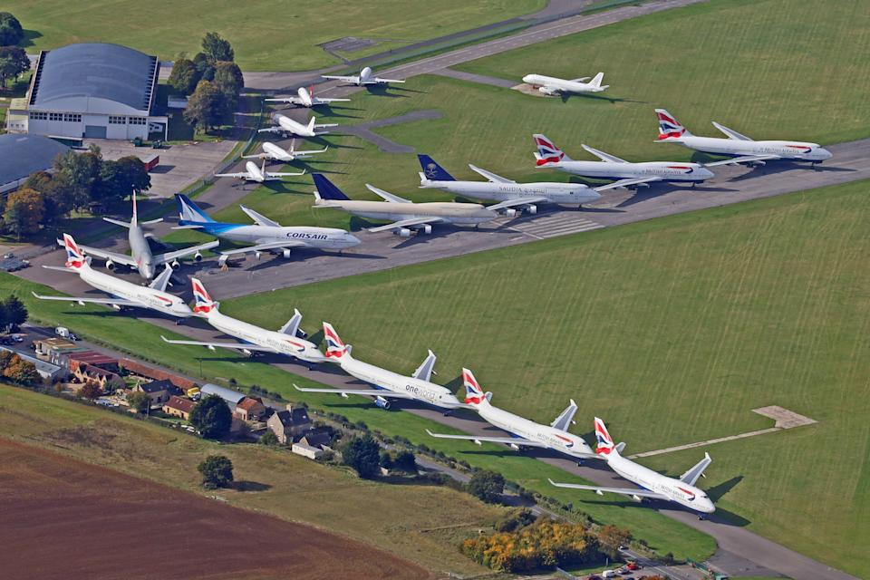 Aerial view of the runway at Kemble airfield where an airplane salvage company has a stock of many craft rendered unviable by the the consequences of Covid 19, October 12 2020. The tarmac is hosting 16 'Jumbos' (Boeing 747s) including the last of BA's fleet G-CIVB which landed here last week.