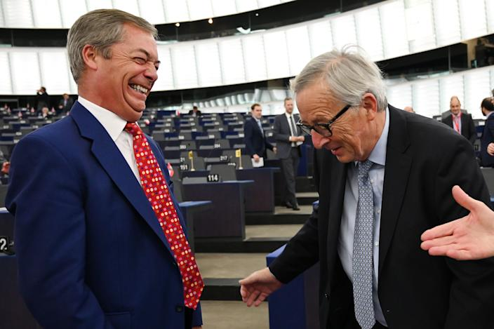 Brexit Party leader Nigel Farage (L) laughs with European Commission President Jean-Claude Juncker before a debate on Brexit at the European Parliament in Strasbourg, northeastern France on September 18, 2019. (Photo by FREDERICK FLORIN / AFP)        (Photo credit should read FREDERICK FLORIN/AFP/Getty Images)