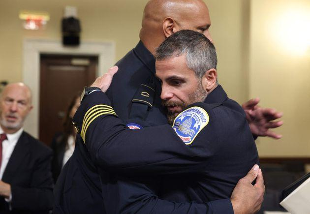 Officer Harry Dunn and Officer Michael Fanone embrace. (Photo: JIM LO SCALZO via Getty Images)