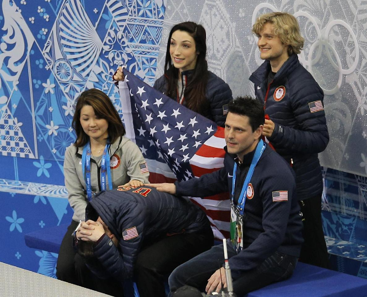 Jeremy Abbott of the United States, centre front, waits for his results after competing in the men's team short program figure skating competition at the Iceberg Skating Palace during the 2014 Winter Olympics, Thursday, Feb. 6, 2014, in Sochi, Russia. (AP Photo/Vadim Ghirda)
