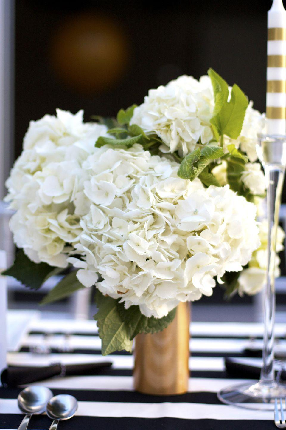 "<p>Gold just seems like the perfect hue to include in a graduation party color palette. Make a handful of these vases and decorate each table.</p><p><strong>Get the tutorial at <a href=""https://www.kristimurphy.com/blog/diy-gold-vase"" rel=""nofollow noopener"" target=""_blank"" data-ylk=""slk:Kristi Murphy"" class=""link rapid-noclick-resp"">Kristi Murphy</a>.</strong></p><p><a class=""link rapid-noclick-resp"" href=""https://go.redirectingat.com?id=74968X1596630&url=https%3A%2F%2Fwww.walmart.com%2Fip%2FEasyLiner-Adhesive-Laminate-20-In-x-6-Ft-Shelf-Liner-Glimmer-Gold%2F163268739&sref=https%3A%2F%2Fwww.thepioneerwoman.com%2Fhome-lifestyle%2Fentertaining%2Fg36014713%2Fgraduation-party-ideas%2F"" rel=""nofollow noopener"" target=""_blank"" data-ylk=""slk:SHOP GOLD CONTACT PAPER"">SHOP GOLD CONTACT PAPER</a></p>"