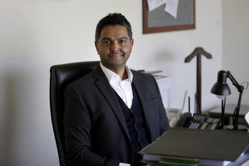 """In this Nov. 20, 2020, photo, Chief Executive of the Pakistan Cricket Board Wasim Khan poses for a photo after an interview with The Associated Press, in Lahore, Pakistan. Pakistan is ready to host major cricketing nations like South Africa, New Zealand, England and West Indies in 2021 after seeing only the sport's lesser-lights in the past five years. """"We're working hugely in terms of building relationships, nurturing those relationships with (other) cricket boards,"""" Khan told The Associated Press. (AP Photo/K.M. Chaudary)"""