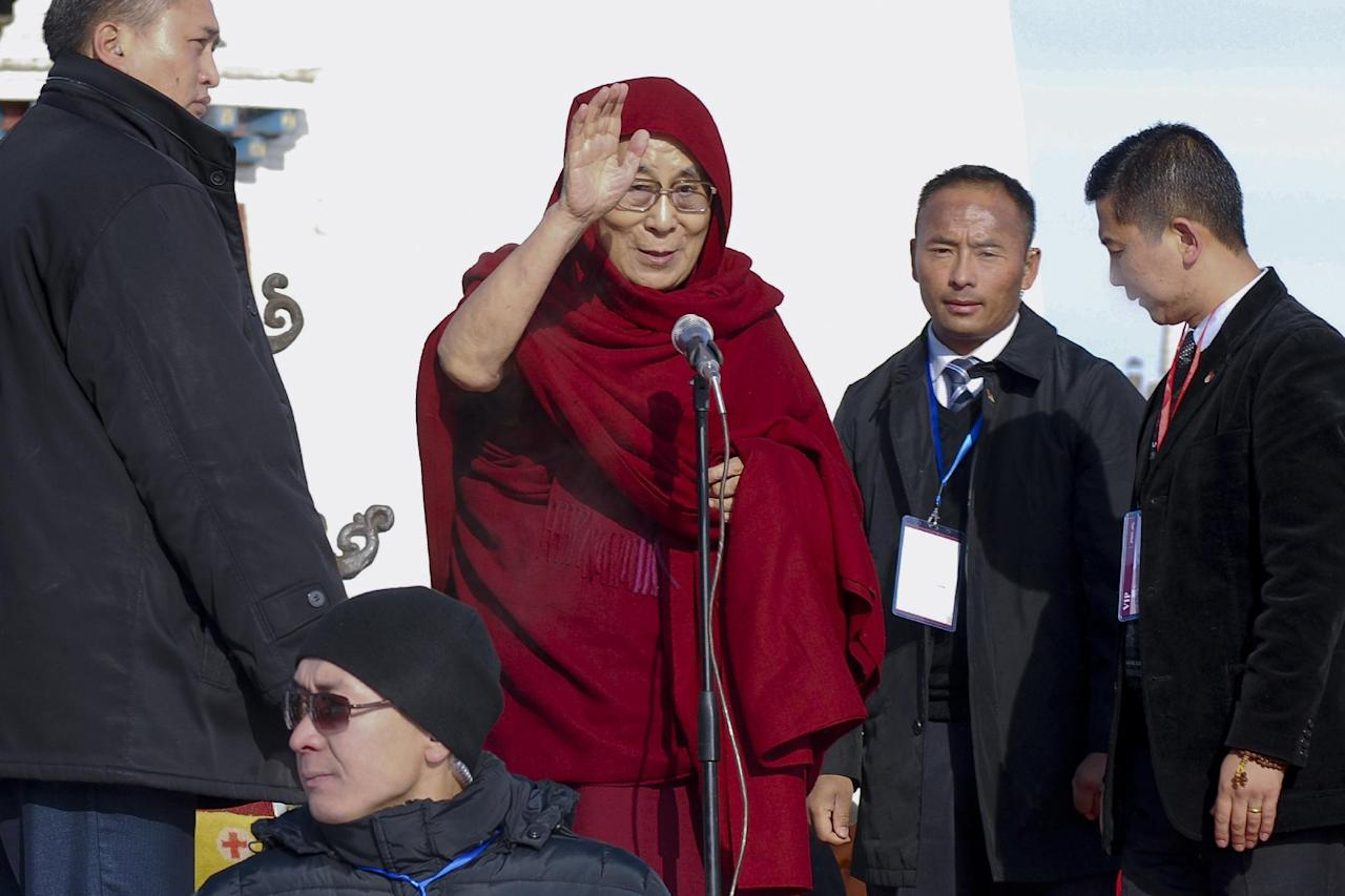 "FILE - In this file photo taken Saturday, Nov. 19, 2016, Dalai Lama, center, waves as he arrives at the Janraiseg temple of Gandantegchinlen monastery to greet Mongolian people in Ulaanbaatar, Mongolia. Exiled Tibetan spiritual leader the Dalai Lama said Wednesday, Nov 23, 2016, he has ""no worries"" about Donald Trump's election as U.S. president and expects the businessman will align his policies with global realities. (AP Photo/ Ganbat Namjilsangarav, File)"