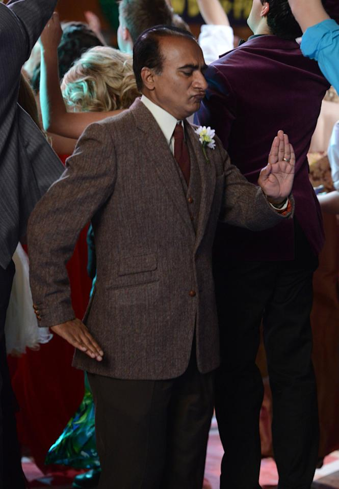 """Principal Figgins (Iqbal Theba) does the robot dance at prom in the """"Prom-asaurus"""" episode of """"<a target=""""_blank"""" href=""""http://tv.yahoo.com/glee/show/44113"""">Glee</a>."""""""