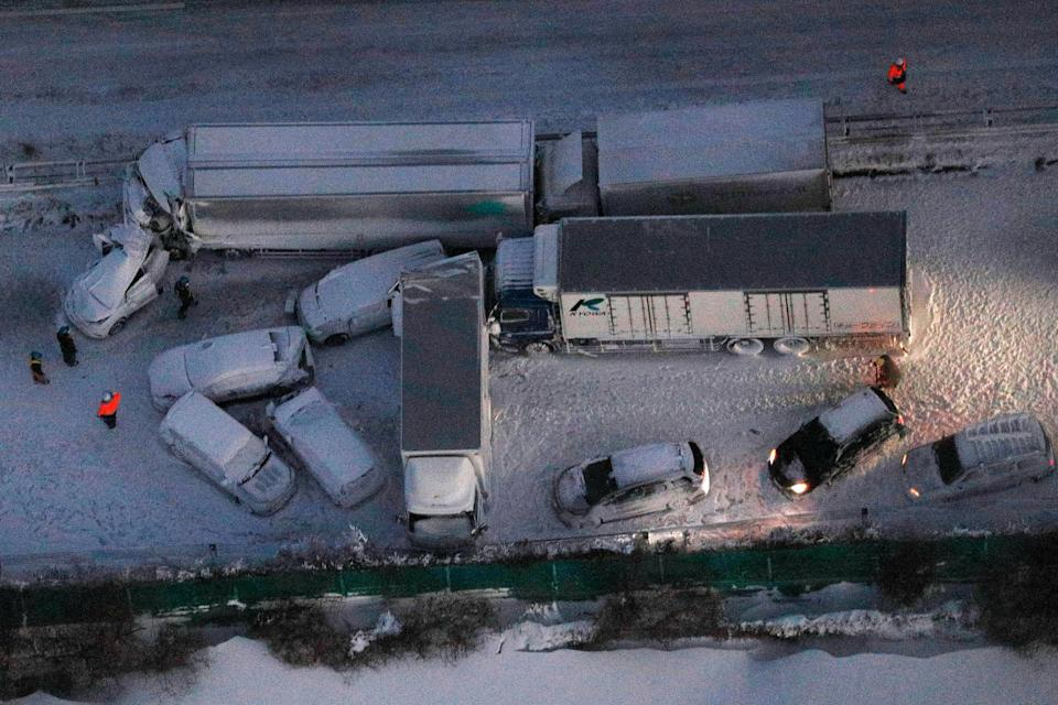 Damaged cars are covered with snow after a multiple accident on the snowy Tohoku ExpresswayAP