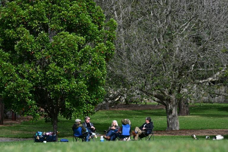 People picnic at the Royal Botanic Garden in Sydney after lockdown rules were eased (AFP/Saeed KHAN)