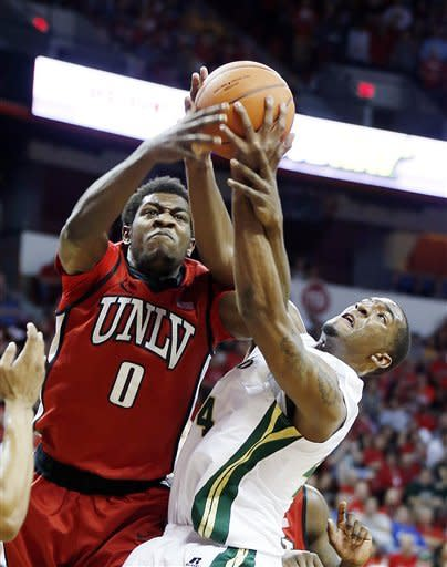 Colorado State's Greg Smith, right, and UNLV's Savon Goodman reach for a rebound during the first half of a Mountain West Conference tournament NCAA college basketball game on Friday, March 15, 2013, in Las Vegas. (AP Photo/Isaac Brekken)