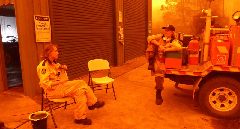 Sisters Sky Threlfall (left), 21 and Siobhan Threlfall (right), 25, outside of the fire shed in quieter times