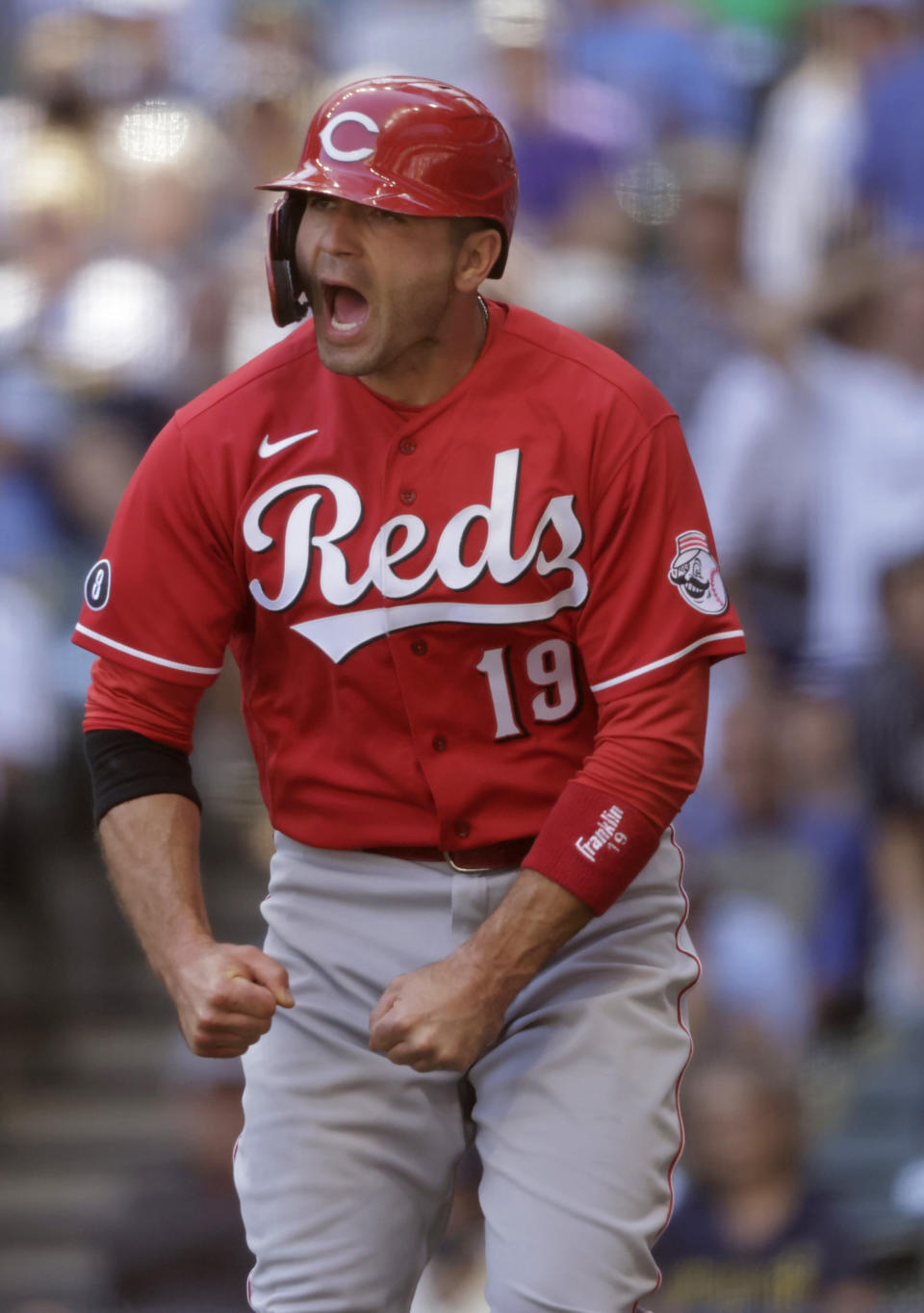 Cincinnati Reds first baseman Joey Votto (19) reacts after scoring during the seventh inning of a baseball game against the Milwaukee Brewers Wednesday, June 16, 2021, in Milwaukee. (AP Photo/Jeffrey Phelps)