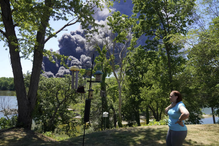 Jessica King looks at the smoke from a chemical plant fire in Rockton, Ill., from her backyard in South Beloit, Ill., Monday, June 14, 2021. (Stacey Wescott/Chicago Tribune via AP)