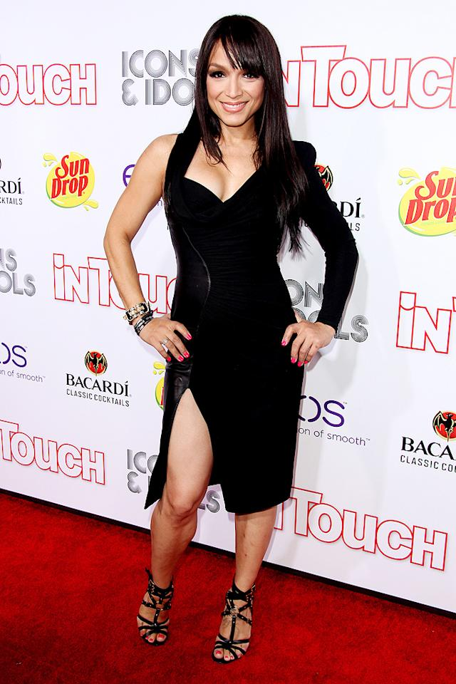 """""""Hollywood Exes"""" star Mayte Garcia, best known for being Prince's wife in the late '90s, showed a little leg at the Icons & Idols party, which followed the VMAs. Coincidentally, 11 years ago, Garcia, a professional dancer, choreographed Britney Spears' iconic """"I'm a Slave 4 U"""" performance at the MTV award ceremony. (9/6/2012)"""