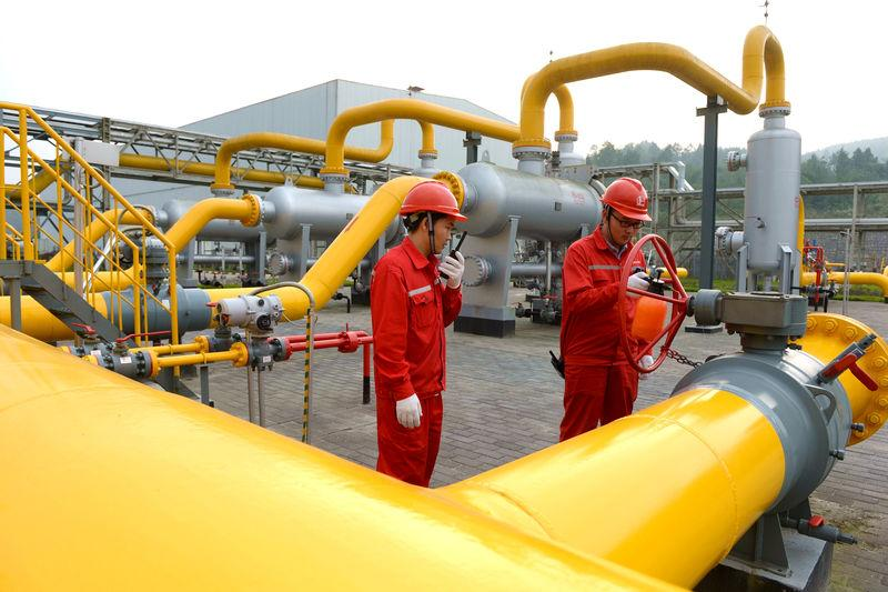 Workers inspect equipment at a shale gas field of Sinopec in Fuling, Chongqing