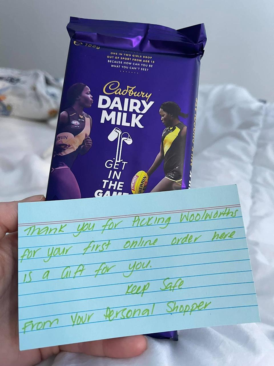 Dairy Milk chocolate and note from Woolworths staff. Source: Facebook