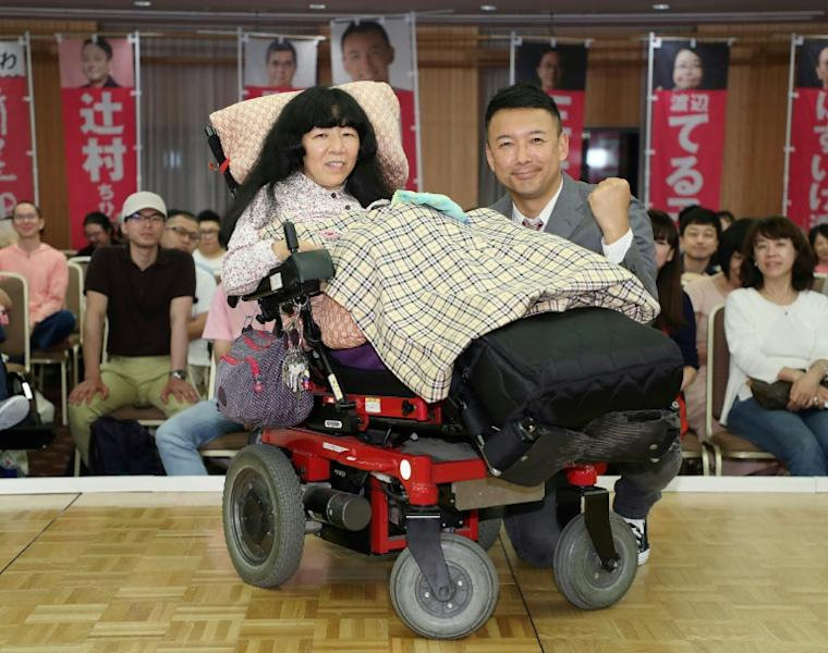 Newly elected lawmaker Eiko Kimura, who is paralysed from the neck down, has called for a system to ensure necessary care for the disabled (AFP Photo/JIJI PRESS)