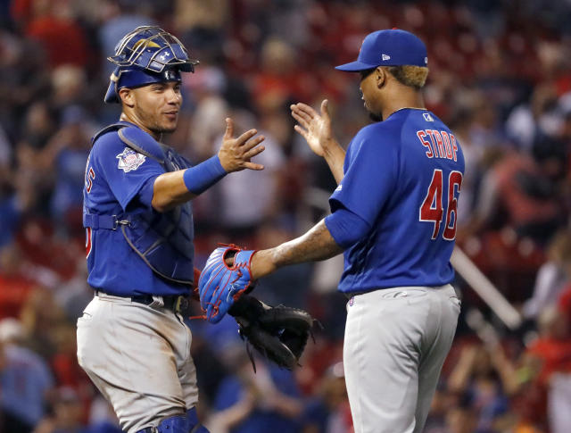 Chicago Cubs catcher Willson Contreras, left, and relief pitcher Pedro Strop celebrate following a baseball game against the St. Louis Cardinals Sunday, July 29, 2018, in St. Louis. The Cubs won 5-2. (AP Photo/Jeff Roberson)