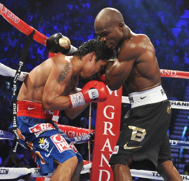 Timothy Bradley (R) of the US attempts to bull Manny Pacquiao (L) of the Philippines into the ropes during their WBO welterweight title match at the MGM Grand Arena on June 9, 2012 in Las Vegas, Nevada.  Unbeaten Bradley ended Pacquiao's long unbeaten run with a controversial split decision victory over the Filipino ring icon.     AFP PHOTO / JOE KLAMARJOE KLAMAR/AFP/GettyImages