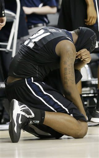 Butler forward Roosevelt Jones (21) reacts after losing 74-72 to Marquette in a third-round NCAA college basketball tournament game on Saturday, March 23, 2013, in Lexington, Ky. (AP Photo/John Bazemore)