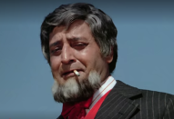 As the naive driver, Kishanlal who gets deceived by his employer, separated from his family, and surfaces years later as a benevolent crime lord in Manmohan Desai's masala blockbuster.