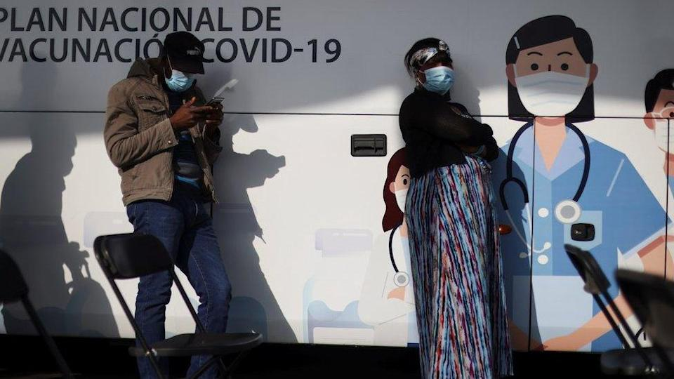 """People wait outside a mobile vaccination centre to receive a dose of Sinovac""""s CoronaVac vaccine against the coronavirus disease (COVID-19) in Santiago, Chile June 16, 2021."""