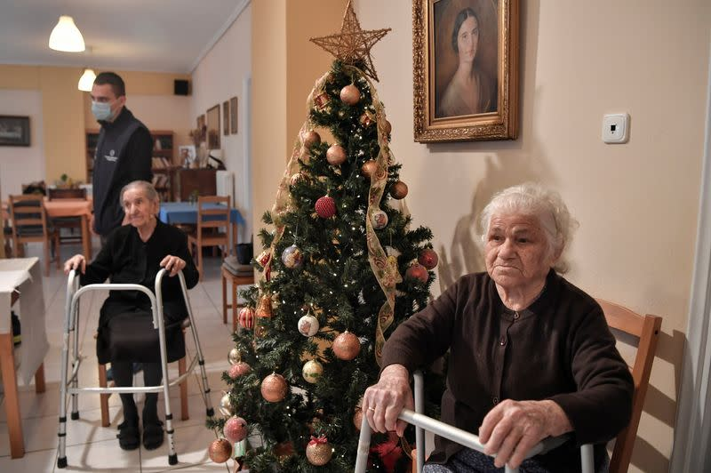 Residents of a nursing home wait to receive a vaccine against the coronavirus disease (COVID-19) in Athens