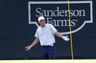Scottie Scheffler reacts to his chip shot on the 18th hole during the second round of the Sanderson Farms Championship golf tournament in Jackson, Miss., Friday, Sept. 20, 2019. (AP Photo/Rogelio V. Solis)