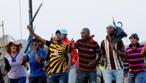 South African miners return to work after strike