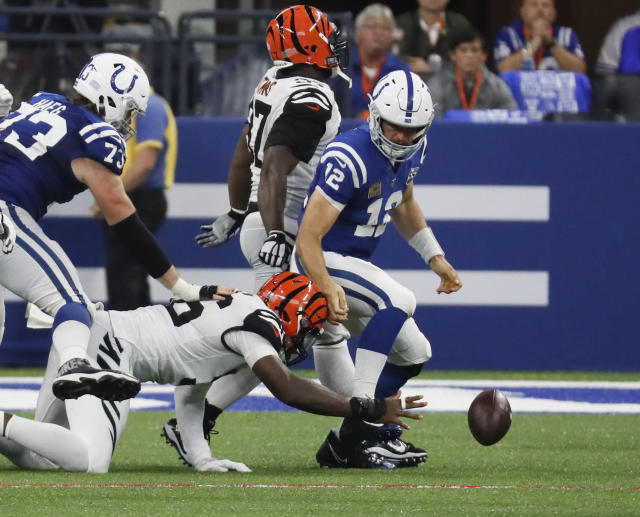 Cincinnati Bengals defensive end Carlos Dunlap (96) strips the ball from Indianapolis Colts quarterback Andrew Luck (12) during the second half of an NFL football game in Indianapolis, Sunday, Sept. 9, 2018. (AP Photo/John Minchillo)
