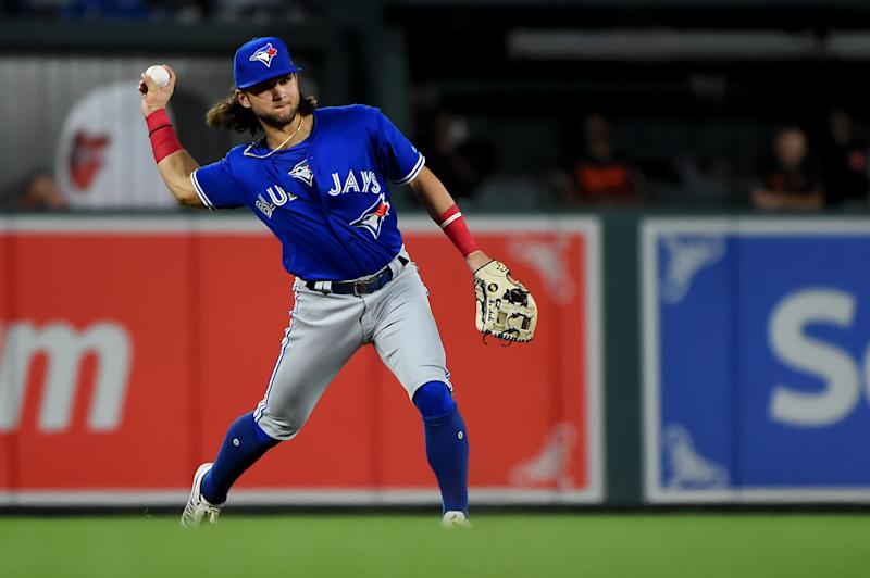 BALTIMORE, MD - AUGUST 02: Bo Bichette #11 of the Toronto Blue Jays throws to first base during the game against the Baltimore Orioles at Oriole Park at Camden Yards on August 2, 2019 in Baltimore, Maryland. (Photo by Will Newton/Getty Images)
