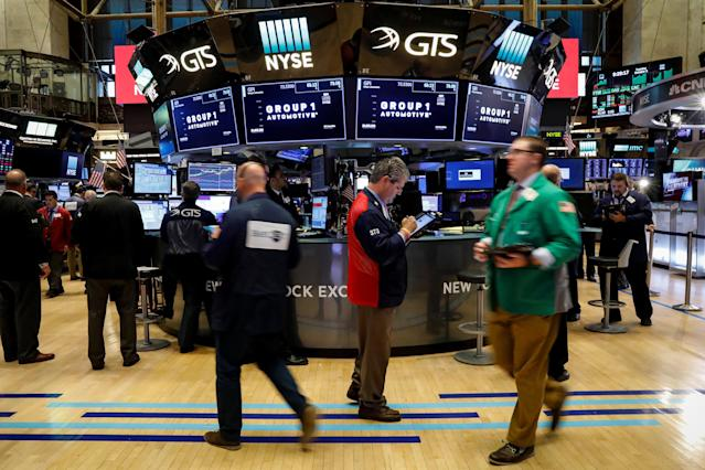 Traders work on the floor of the New York Stock Exchange (NYSE) in New York, U.S., October 3, 2017. REUTERS/Brendan McDermid