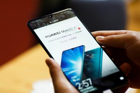 A man holds a Huawei Mate 20 X 5G smartphone at the International Consumer Electronics Expo in Beijing