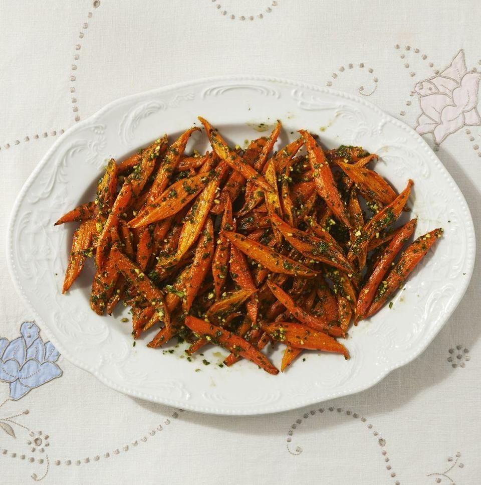 """<p>Pesto makes everything better! Try making your own with toasted almonds and different herbs like mint and parsley. It pairs well with simple roasted carrots. </p><p><a href=""""https://www.thepioneerwoman.com/food-cooking/recipes/a35904732/roasted-carrots-with-spring-pesto-recipe/"""" rel=""""nofollow noopener"""" target=""""_blank"""" data-ylk=""""slk:Get Ree's recipe."""" class=""""link rapid-noclick-resp""""><strong>Get Ree's recipe.</strong></a></p>"""