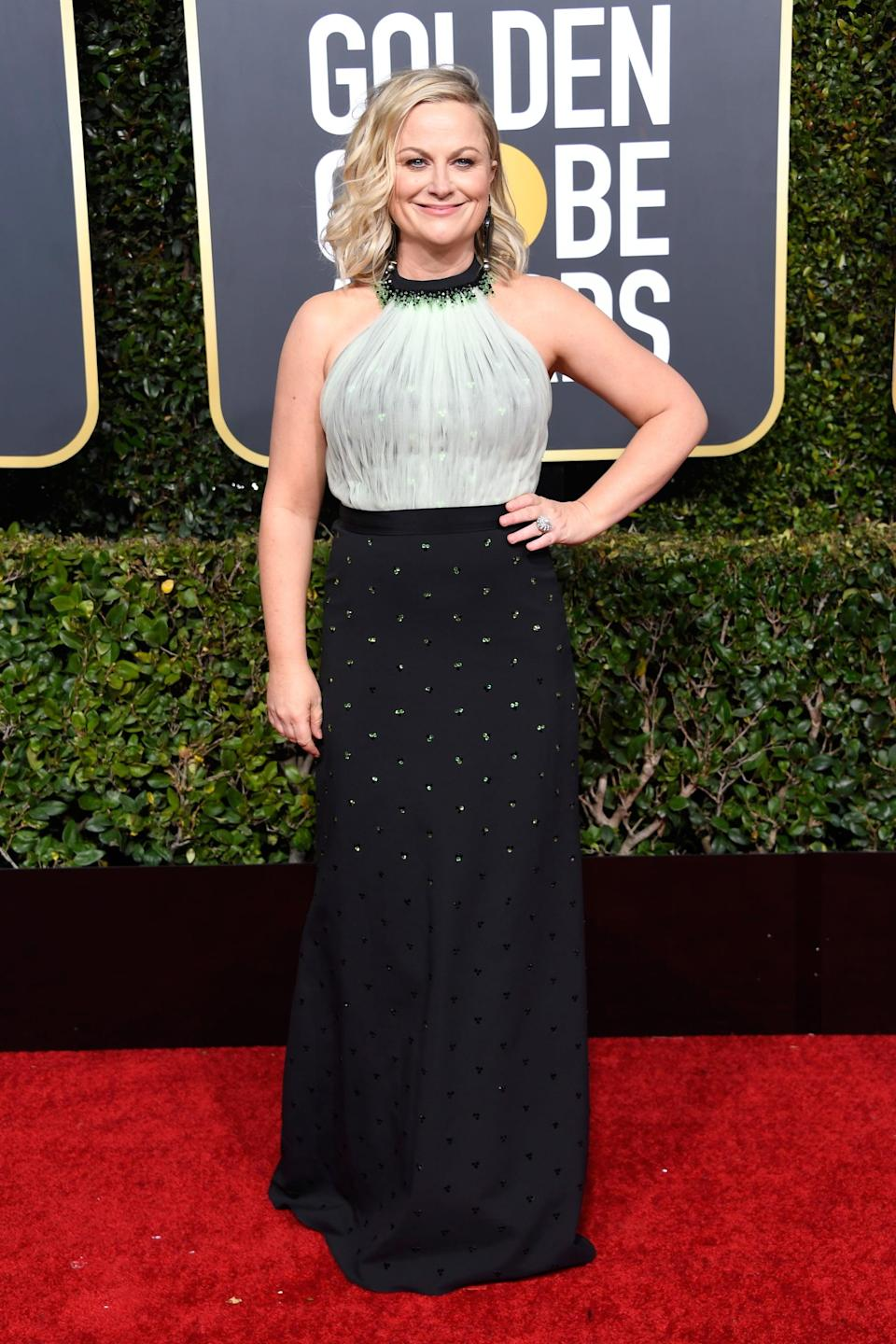 <p>Wearing a Viktor and Rolf dress with Brian Atwood shoes and Silvia Furmanovich earrings.</p>