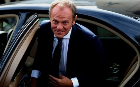 European Council President Donald Tusk arrives at the presidential palace for a meeting with Cyprus' President Nicos Anastasiades in divided capital Nicosia - Credit: Petros Karadjias/AP