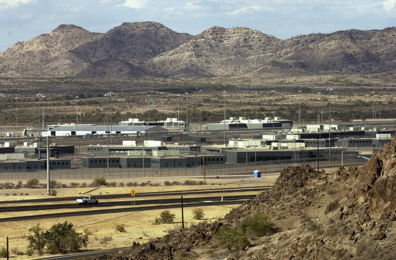 FILE - This Jan. 20, 2004, photo shows the Arizona State Prison Complex-Lewis in Buckeye, Arizona. A new report says locks failed for years at an Arizona prison and allowed for serious beatings of prisoners and guards, but Department of Corrections Director Charles Ryan failed to appreciate the seriousness of the problem until video of an assault was broadcast on television. (AP Photo/Tom Hood, File)