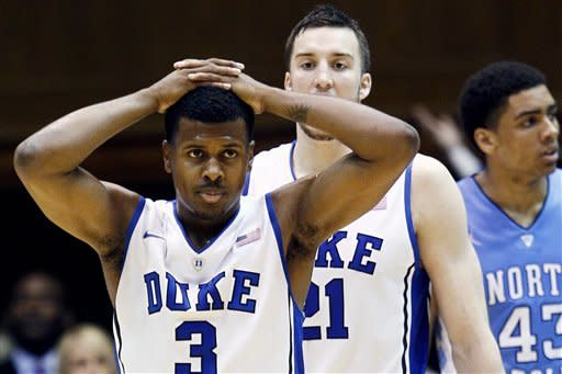 Duke's Tyler Thornton (3) and Miles Plumlee react towards the end of an NCAA college basketball game against North Carolina in Durham, N.C., Saturday, March 3, 2012. North Carolina won 88-70. At rear is North Carolina's James Michael McAdoo (43). (AP Photo/Gerry Broome)