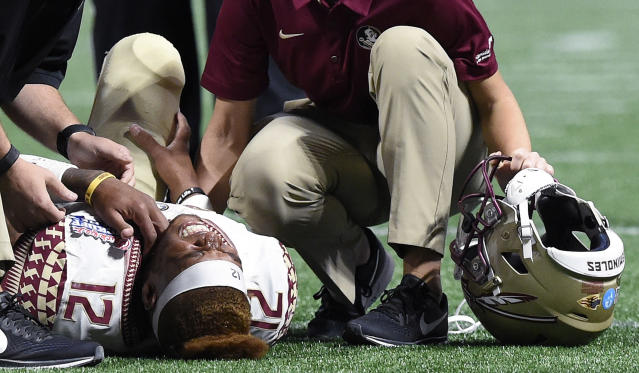 "<a class=""link rapid-noclick-resp"" href=""/ncaaf/players/256791/"" data-ylk=""slk:Deondre Francois"">Deondre Francois</a> reacts to his injury against Alabama defensive back Ronnie Harrison during the second half of an NCAA football game, Saturday, Sept. 2, 2017, in Atlanta. Alabama won 24-7. (AP Photo/Mike Stewart)"