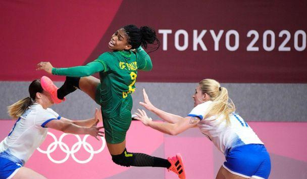 PHOTO: Brazil's Bruna de Paula, centre, scores during the women's preliminary round group B handball match between Russian Olympic Committee and Brazil at the 2020 Summer Olympics, Sunday, July 25, 2021, in Tokyo, Japan. (Sergei Grits/AP Photo)