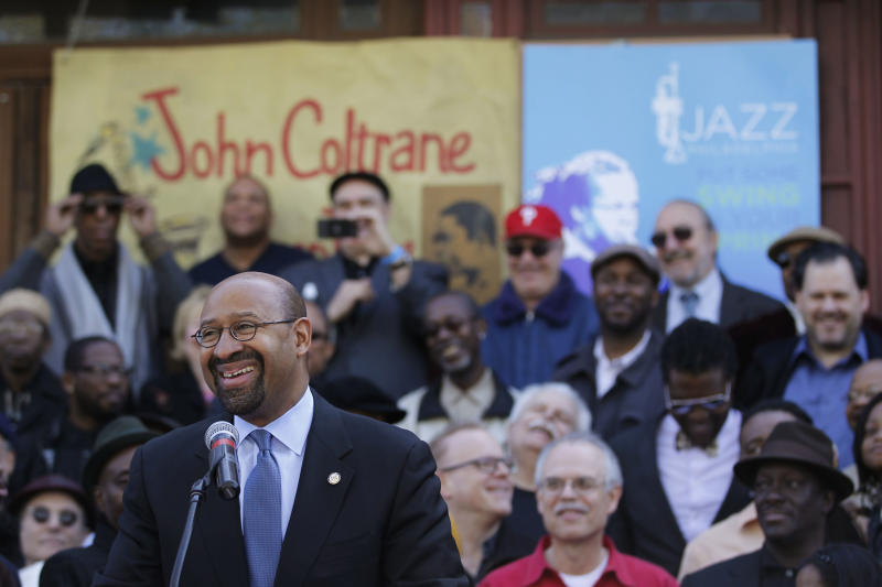 Mayor Michael Nutter, speaks outside of the former home of jazz musician John Coltrane, Friday, April 13, 2012, in Philadelphia. Jazz lovers and cultural officials in Philadelphia are promoting a fundraising effort to save the run-down house. Coltrane lived in a rowhouse in the city's Strawberry Mansion neighborhood from 1952 to 1958. (AP Photo/Matt Rourke)