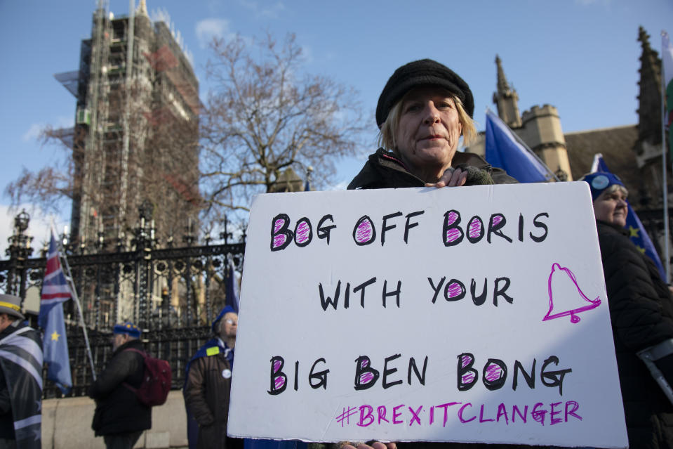 Anti Brexit protester with a placard reading 'Bog off Boris with your Big Ben bong' as a protest of the plan to potentially let Big Ben chime at midnight on 31st January, this protester is ringinga small bell for £5 instead of the £500,000 it is said it will cost to bring the chime back for the 31st at Westminster outside Parliament on 15th January 2020 in London, England, United Kingdom. With a majority Conservative government in power and Brexit day at the end of January looming, the role of these protesters is now to demonstrate in the hope of the softest Brexit deal possible. (photo by Mike Kemp/In Pictures via Getty Images)