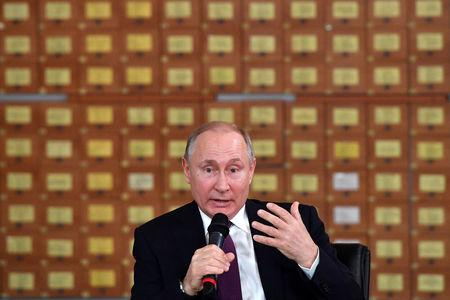 Russian President Vladimir Putin meets with members of the public in Simferopol