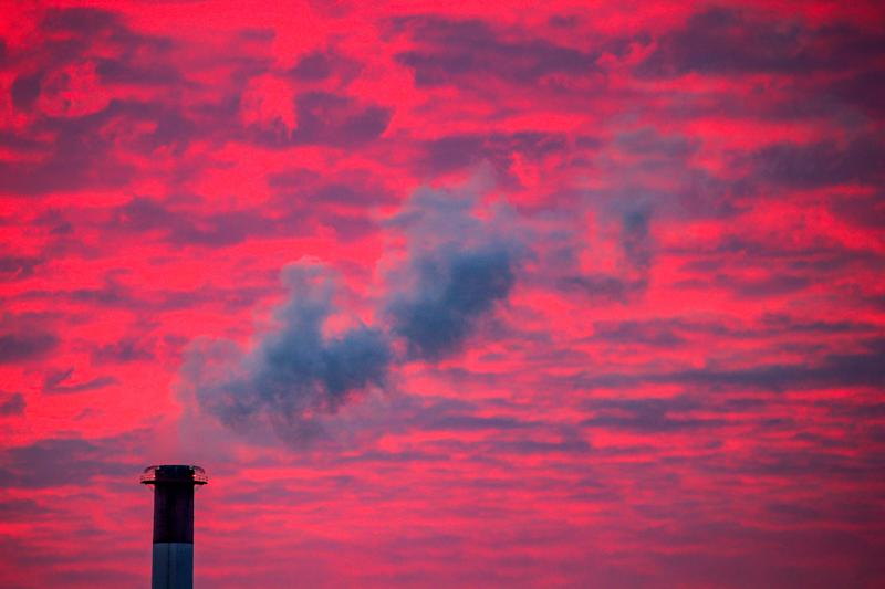 Steam rises from a smokestack at sunset in Lansing, Michigan. (Brendan McDermid / Reuters)