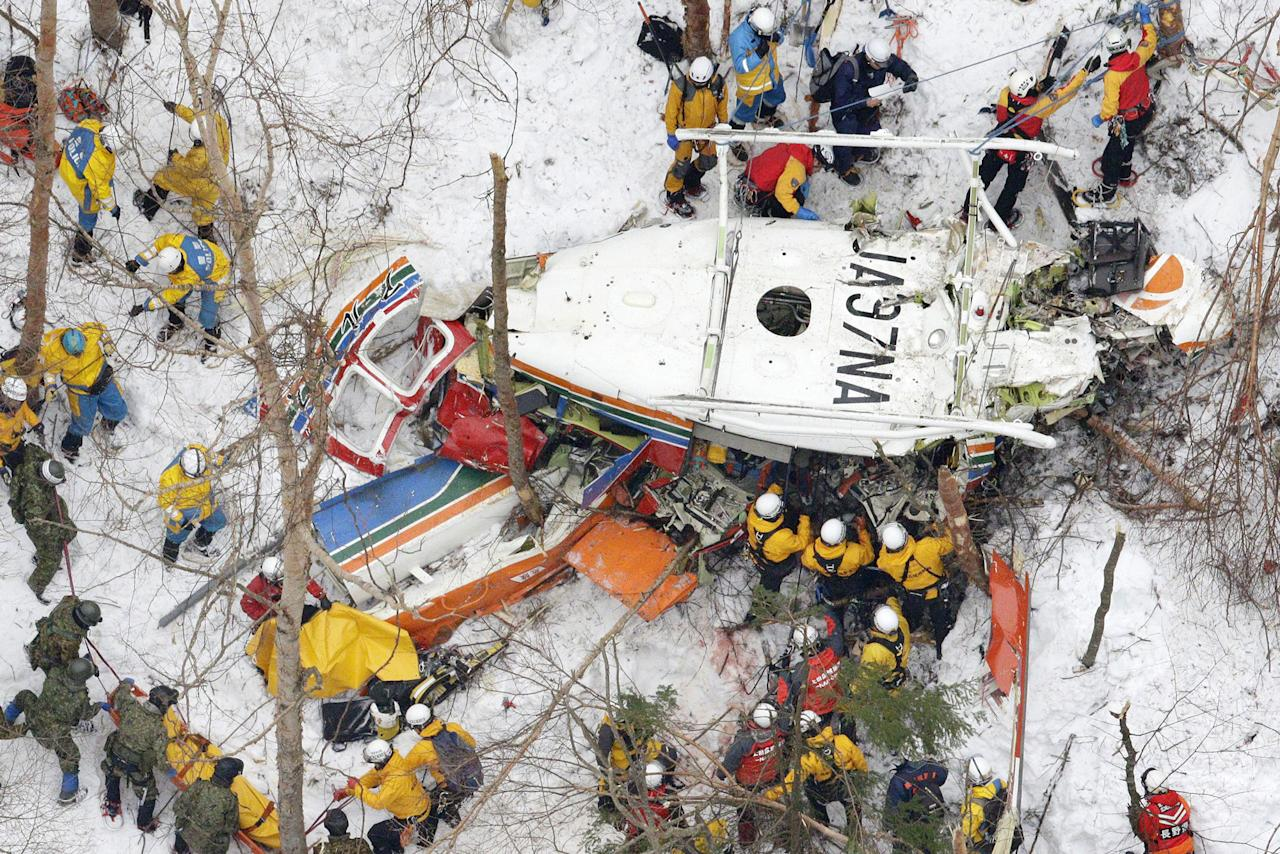 <p>Rescuers work near the helicopter crashed in mountains in Nagano prefecture, central Japan Monday, March 6, 2017. Japanese authorities confirmed Monday that all nine people aboard a rescue helicopter that crashed in snow-covered mountains in central Japan have been pronounced dead. (Yohei Kanasashi/Kyodo News via AP) </p>