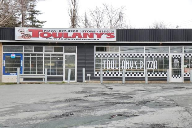 Three people, including the owner of Toulany's Pizza in Porters Lake, N.S., have been fined $1,000 each for failing to wear a mask in a public place. (Paul Palmeter/CBC - image credit)