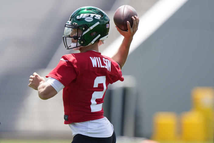 New York Jets quarterback Zach Wilson prepares to pass during an NFL football practice, Thursday, May 27, 2021, in Florham Park, N.J. (AP Photo/Kathy Willens)