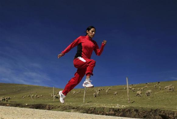 "Marathon runner Gladys Tejeda, the first Peruvian athlete who qualified for the 2012 London Olympic Games, runs during her training in the Andean province of Junin, May 14, 2012. A private company will take Tejeda's mother Marcelina Pucuhuaranga, 69, to London as part of the ""Thank you Mom"" program. For Pucuhuaranga, who received her first passport, it will be the first time traveling out of Peru."
