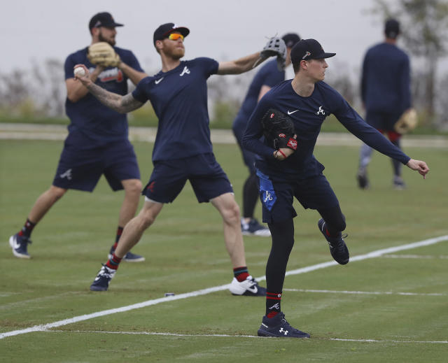 Atlanta Braves pitchers, from left, Shane Greene, Mike Foltynewicz and Max Fried loosen up at spring training baseball camp in North Port, Fla., Wednesday, Feb. 12, 2020. (Curtis Compton/Atlanta Journal-Constitution via AP)
