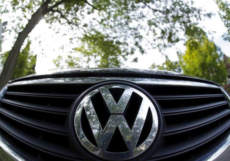 The logo of German carmaker Volkswagen is seen on the front grill of a Passat car in Willmette